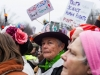 A woman catches my camera while speakers took the stage at the Women's March on Washington on Saturday. Her DIY hat is a recurrent critic of Trump's tweeting habits. Seconds after she caught my camera's glance, she smiled. (THE EYEOPENER/Andrej Ivanov)