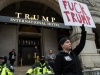 A protester stands in a makeshift no man's land, made by police, meant to separate marchers from the Trump International Hotel in Washington D.C. The Hotel is built into the Old Post Office Pavilion and was leased to the Trump Organization by the U.S. General Services Administration. (THE EYEOPENER/Andrej Ivanov)