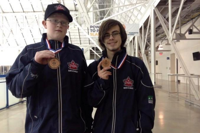 The two boys. Alex Angus and Dominick Tait proudly holding their bronze medals that they earned over the weekend. Photo: Luke Galati