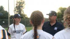 Ryerson's new fastpitch team discusses tactics before their inaugural game.PHOTO: CHRIS BLANCHETTE