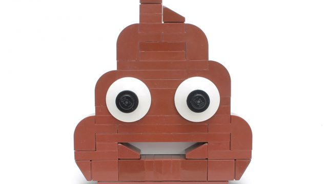A smiling poop emoji made of Lego