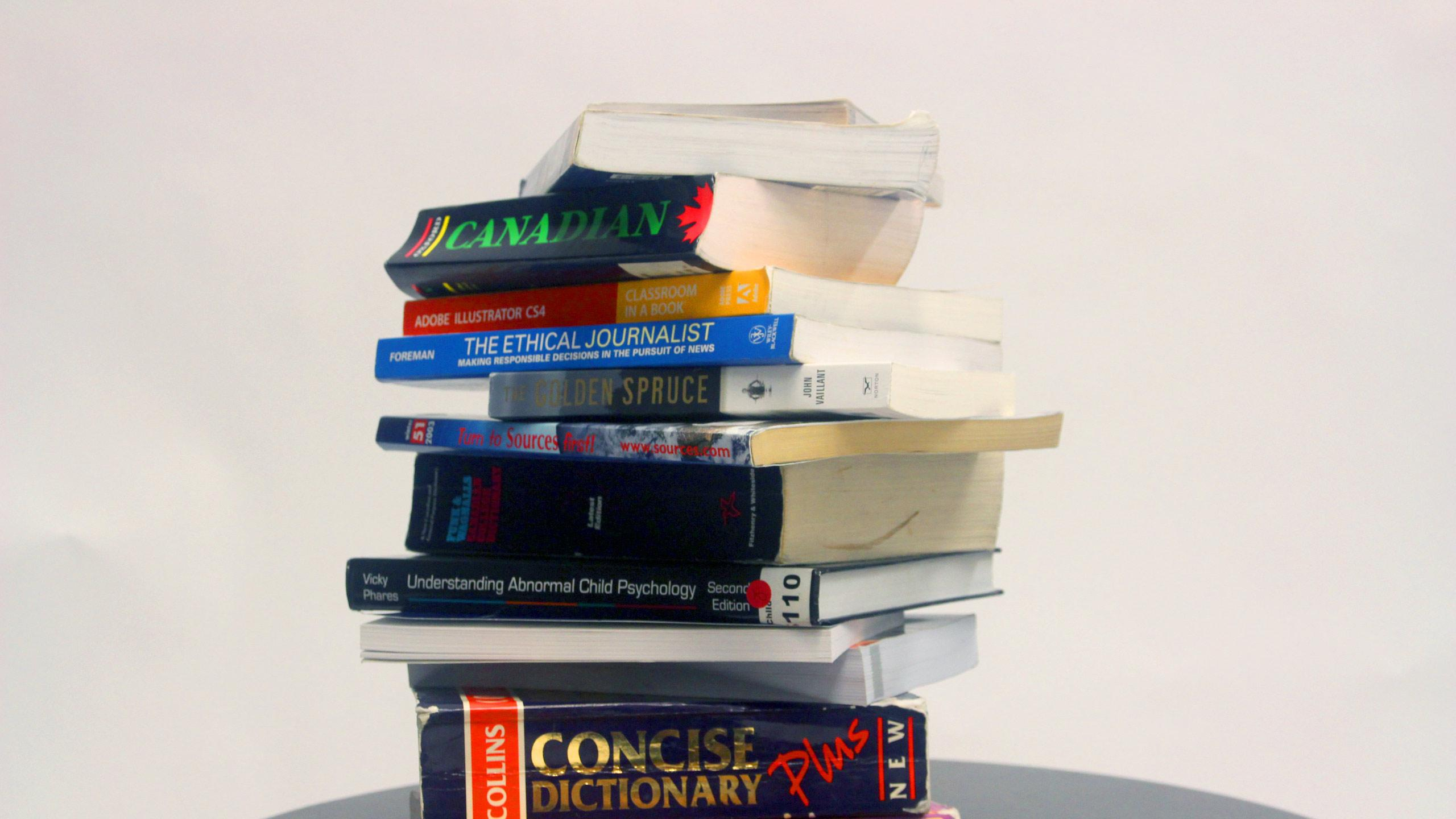 A stack of print textbooks.