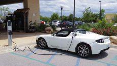 A Tesla electric car plugged into a charging station. PHOTO: ZOBEID ZUMA/FLICKR