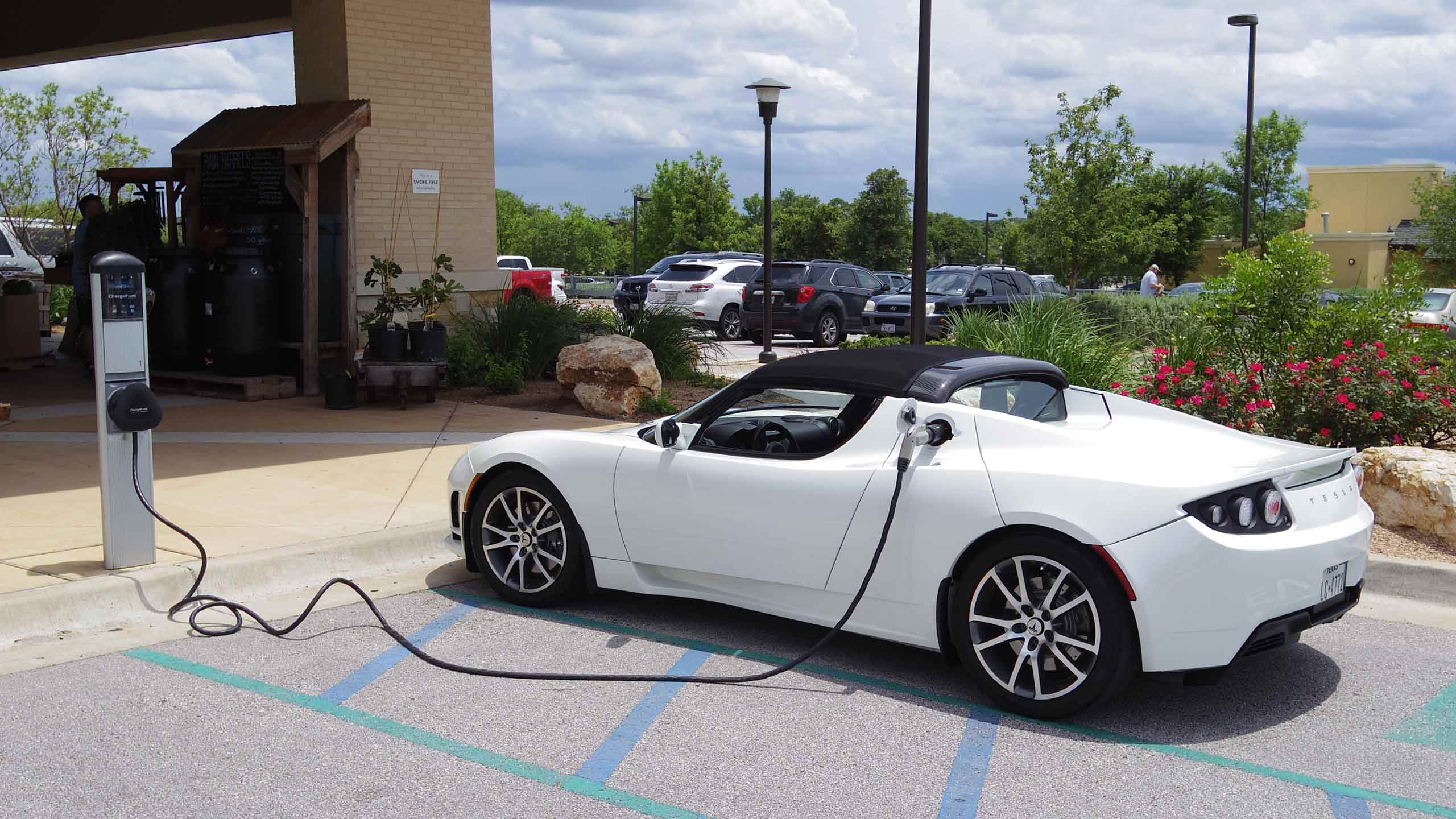 A Tesla electric car plugged into a charging station. PHOTO: ZOBEID ZUMA/FLICKR