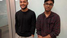 Satchel French and Aditya Surabi stand side-by-side against a wall.