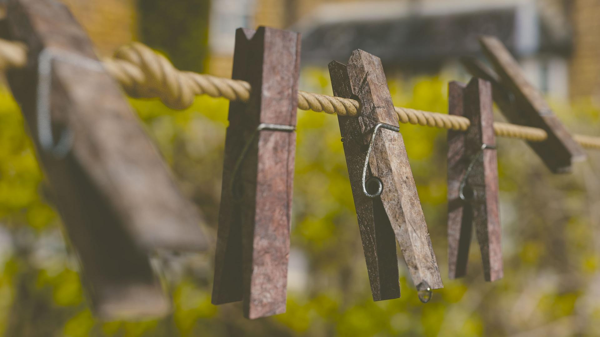 Wooden clothes pins on a twine clothesline