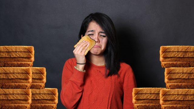 A sad girl and her sad, sad bread. PHOTO ILLUSTRATION: CHRIS BLANCHETTE