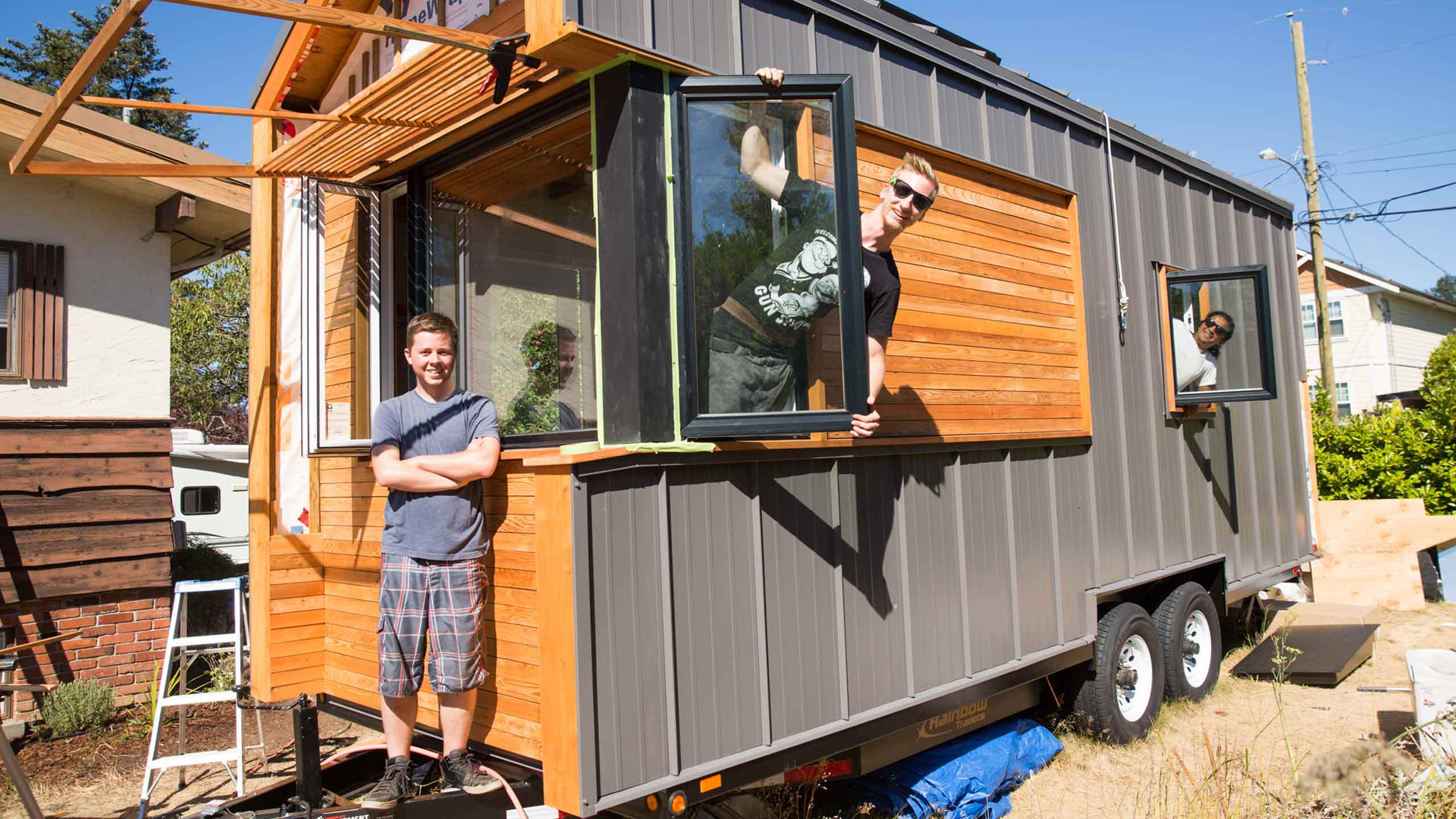 From left: Douglas Peterson-Hui, Daniel Sobieraj and Gregorio Jimenez with their completed tiny home. PHOTO COURTESY JACOB ZINN