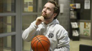 Our photo editor, Devin Jones, holds a basketball while in deep thought.