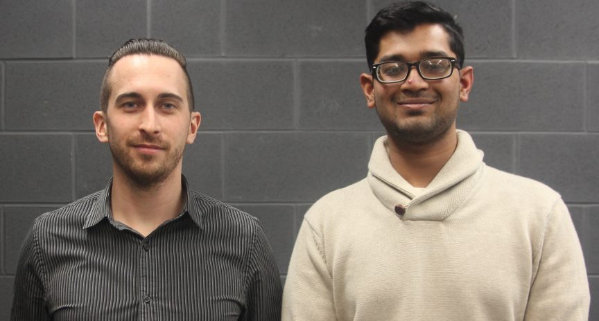 Francis Picotte, founder of the Ryerson Space Society and Abhinav Sundar, vice president of operations, stand side-by-side facing the camera.