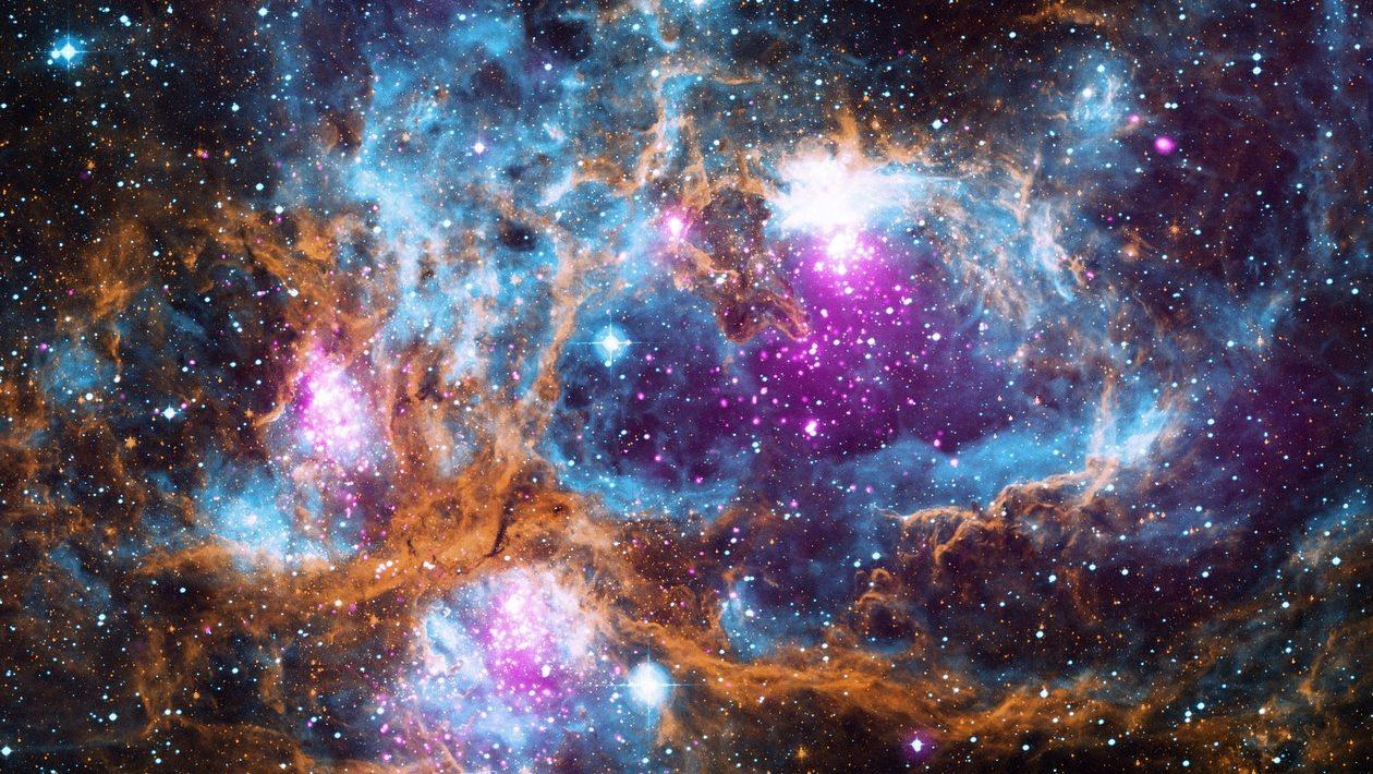 Vast clusters of stars and space dust.
