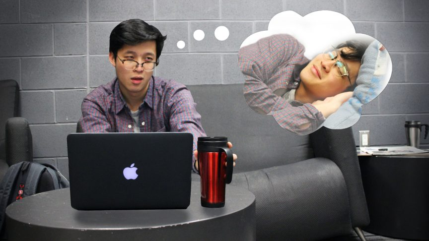 A guy at a work desk dreams about sleeping