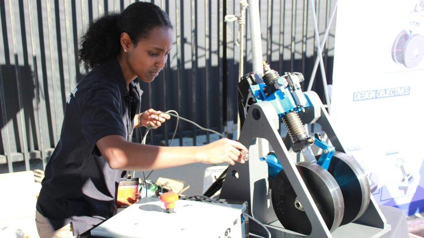 Hyperloop team member Wintta Ghebreiyesus adjusts the team's wheel system.