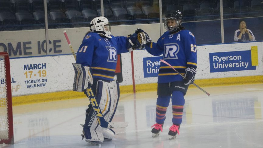 Two ryerson hockey players bump hands