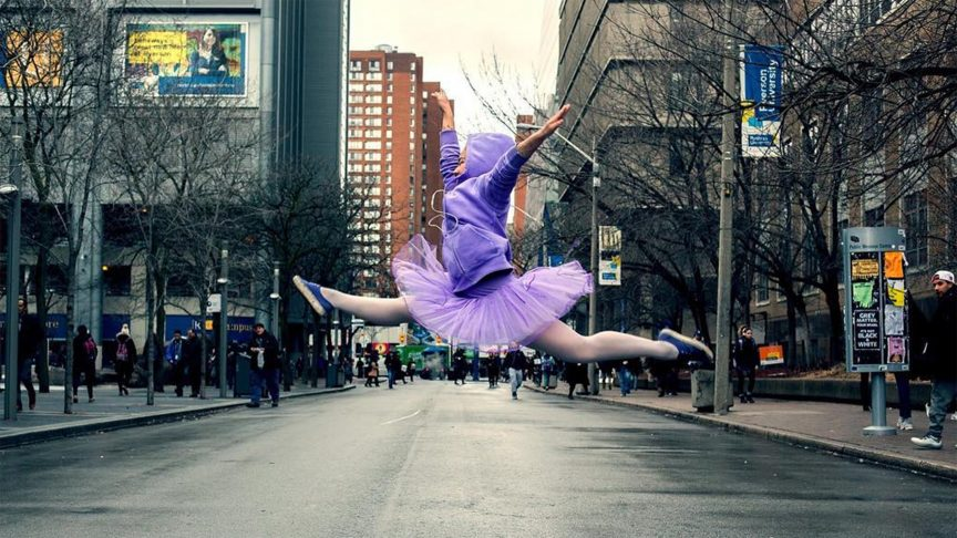 a ballerina dressed in purple prances across Gould Street