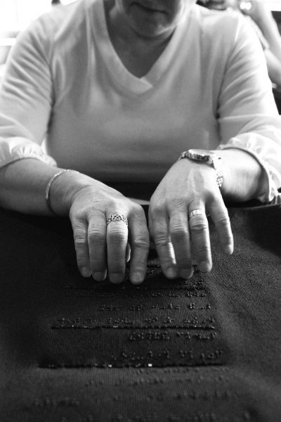 A woman reading braille.