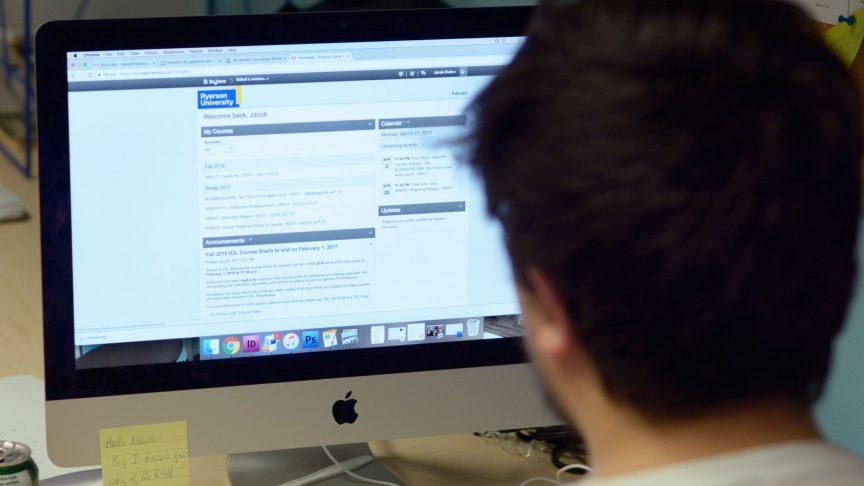 Student using D2L on a desktop computer