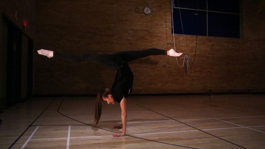 Gymnast doing handstand splits
