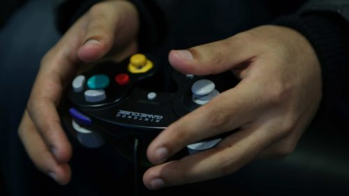 Monib's hands on a controller