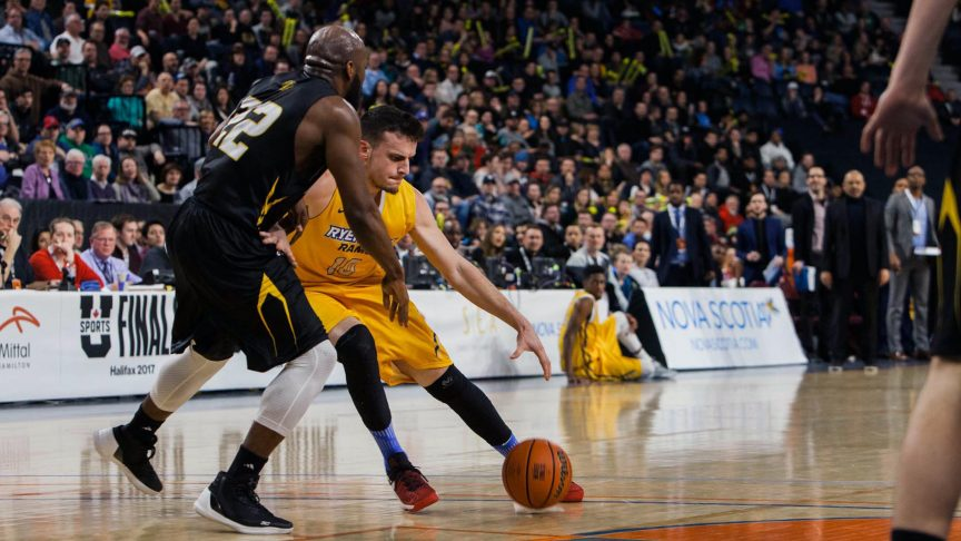 A Ryerson player battles it out on the court against a Dalhousie player, at the March 11 semifinals