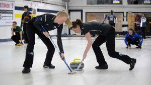 Ryerson curling and sweeping down the ice