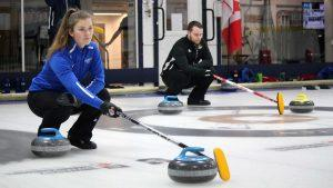 Two curlers lining up shot