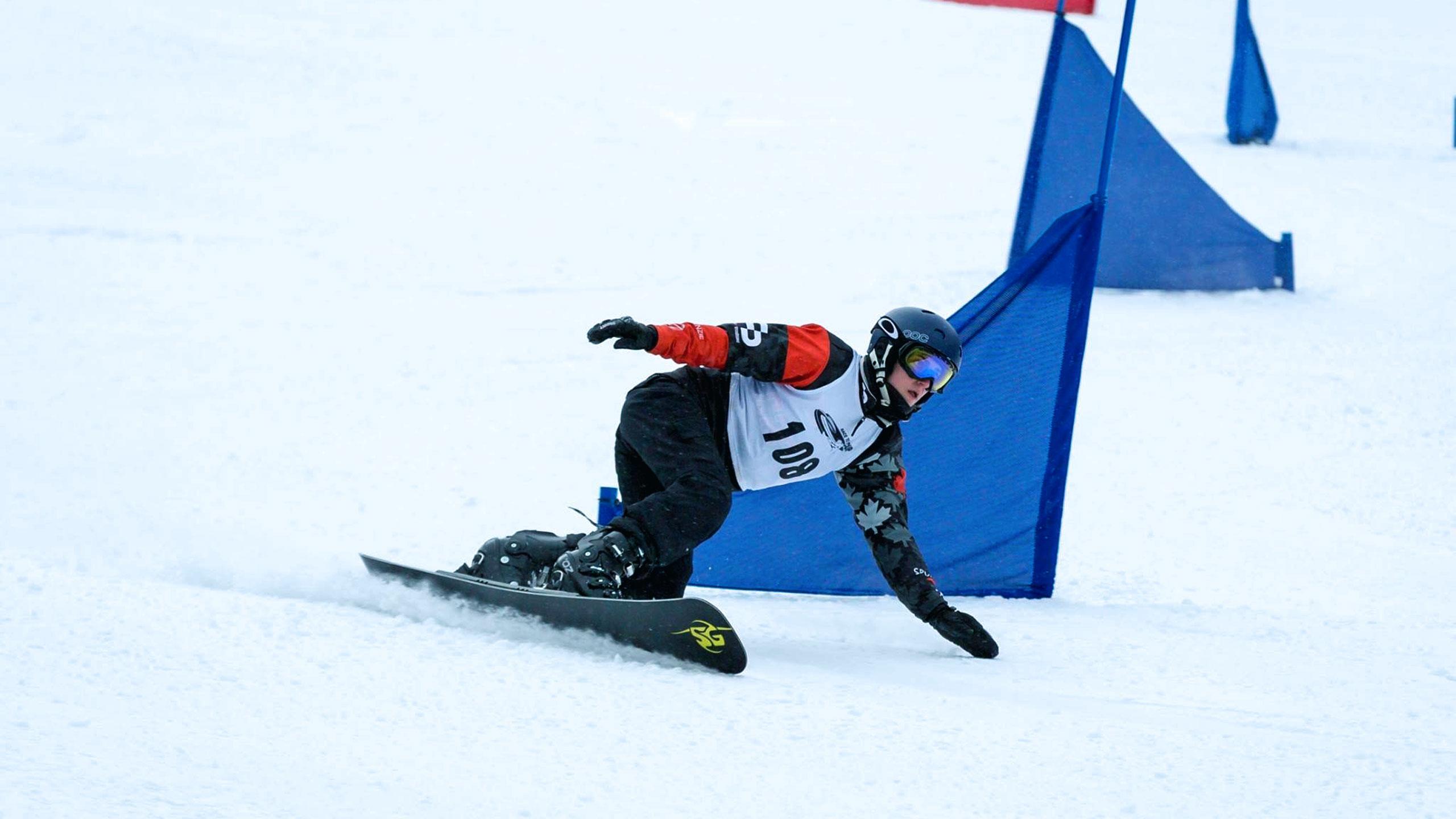 Jennifer Hawkrigg snowboards down a snowy hill
