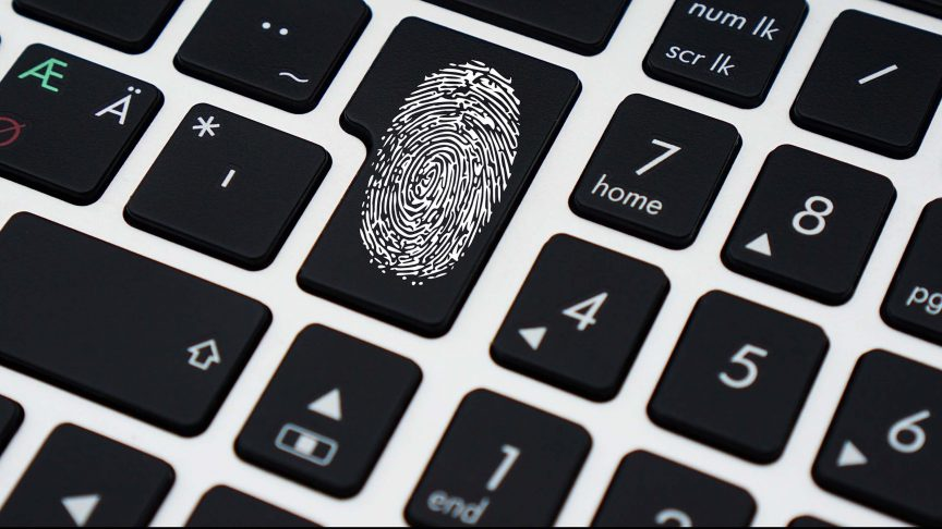 A fingerprint is visible on a keyboard