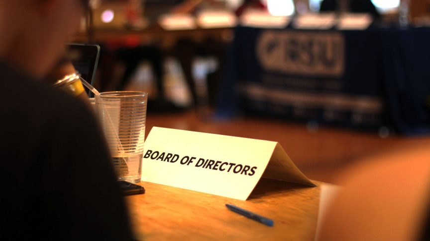 "Title card on table with ""Board of Directors"" written on it"