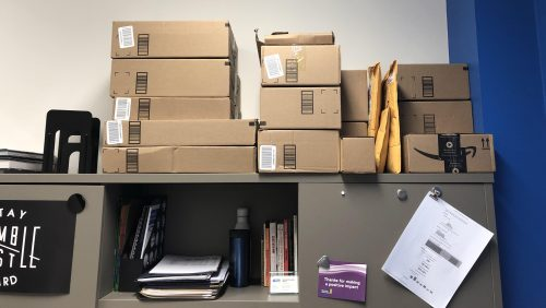 a lot of amazon cardboard boxes stacked onto a shelf