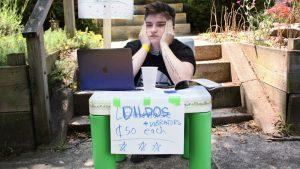 Ryerson student union member selling dildos at a plastic table lemonade stand