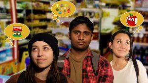 A line of young people in a store, thinking about what they're hoping to buy.