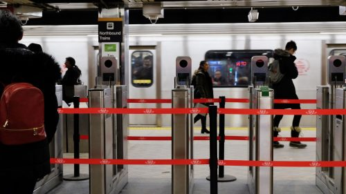 Fare gates roped off with red rope.