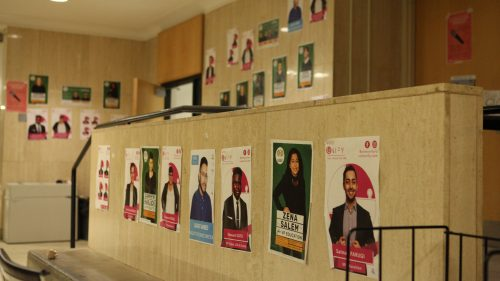 An array of RSU candidate posters on a wall.