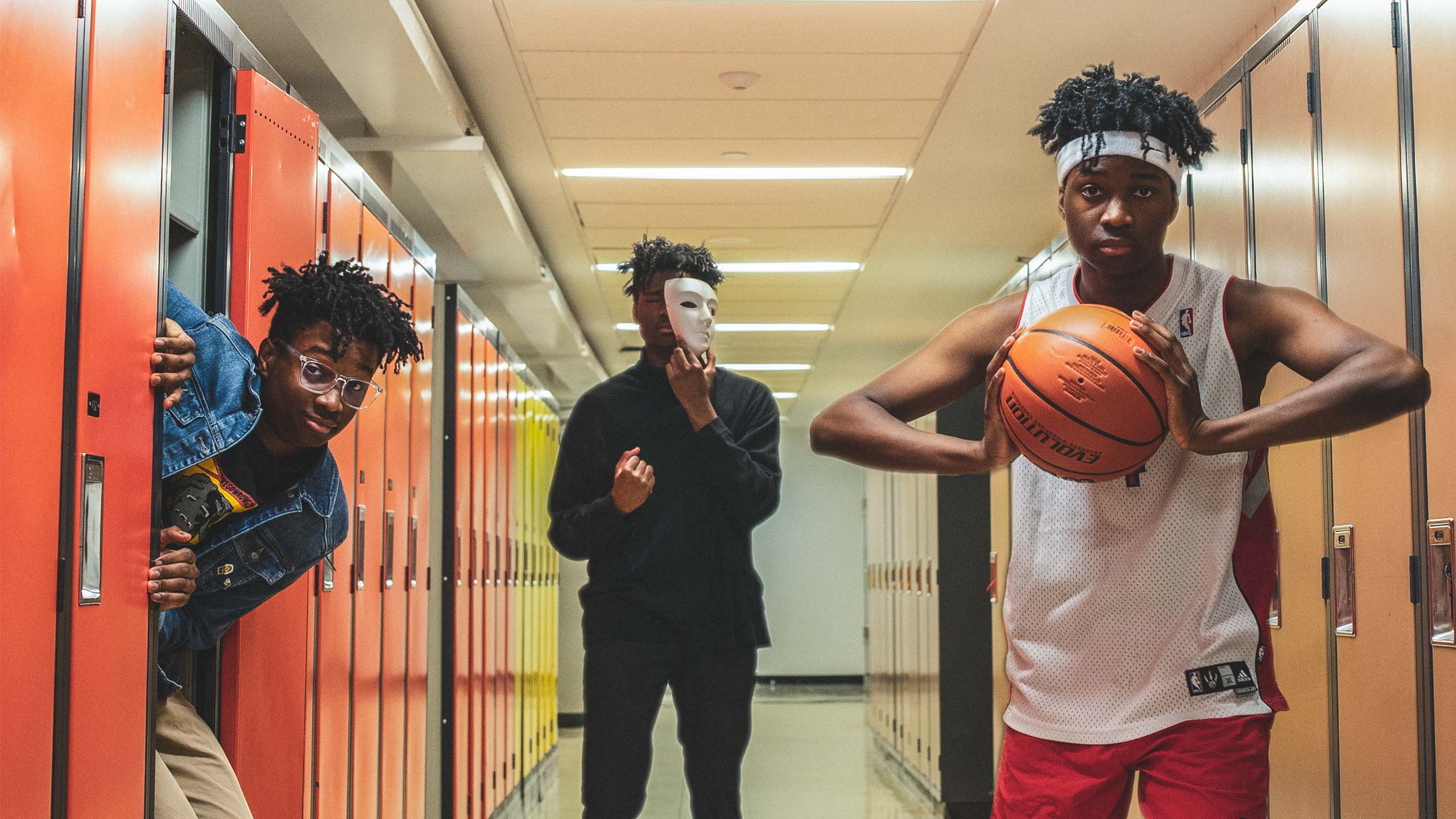 3 versions of the same student with different personalities line the halls of Ryerson. One is a jock holding a basketball, one is an artist holding a theatre mask, and one is a nerd stuffed in a locker.