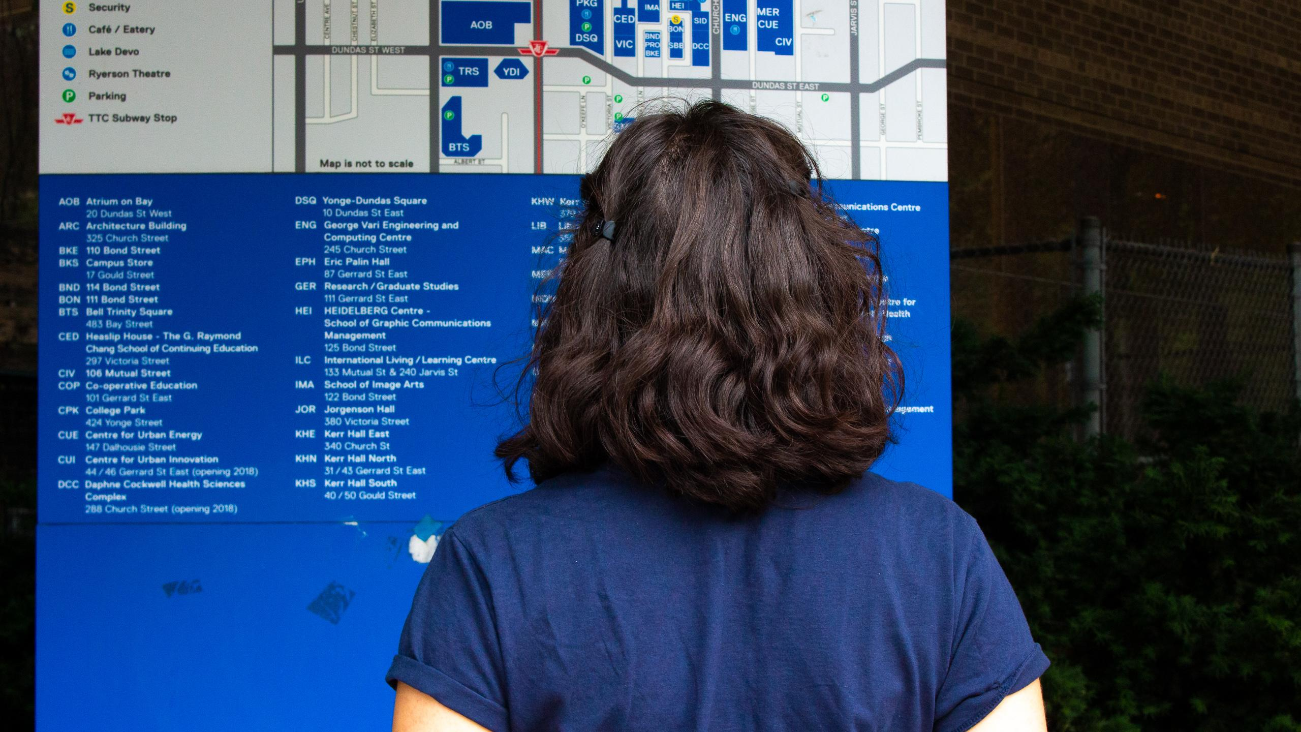 Person standing in front of Ryerson map