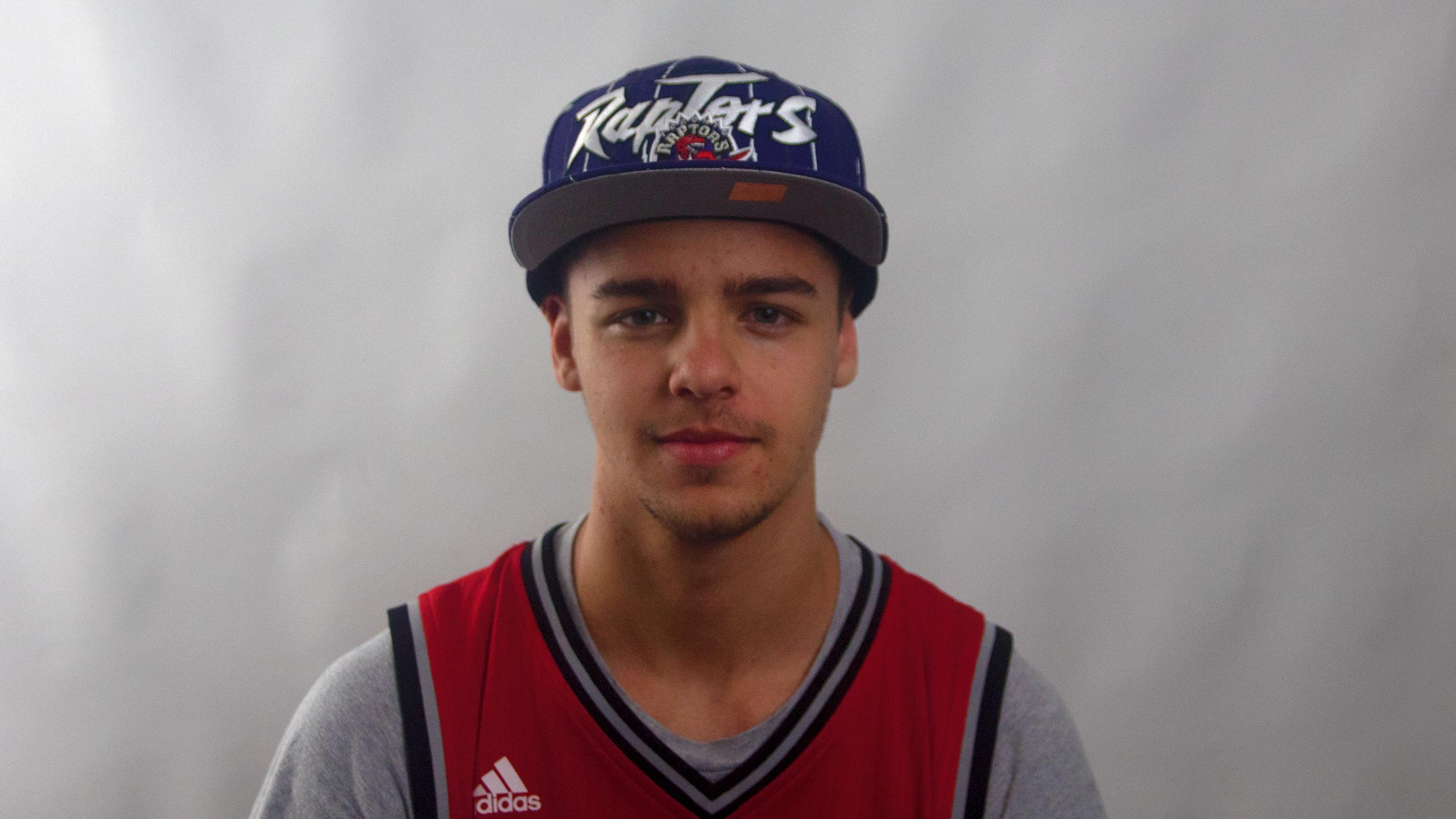 First year university athlete wearing a raptors cap and jersey