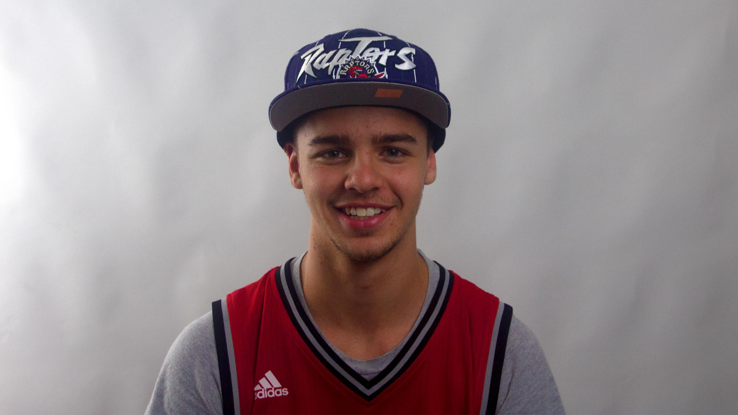 Eager first year university athlete wearing a raptors cap and jersey