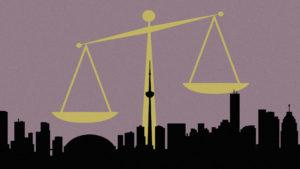 An illustration of weigh scales dwarfing a silhouette of the Toronto skyline