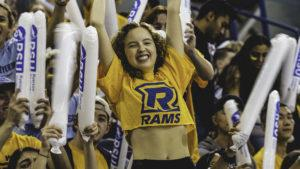 Photo of a female fan at the Ryerson homecoming hockey game dressed in Rams gear