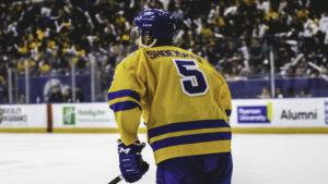 Photo of a male Ram's hockey player on the ice during the homecoming game