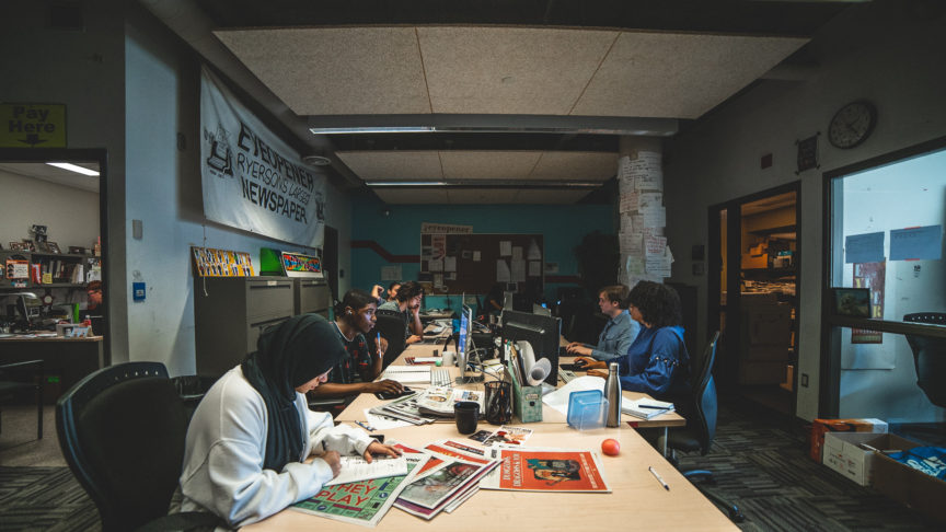 A photo of the Eyeopener Fall 2019 Masthead working in their office
