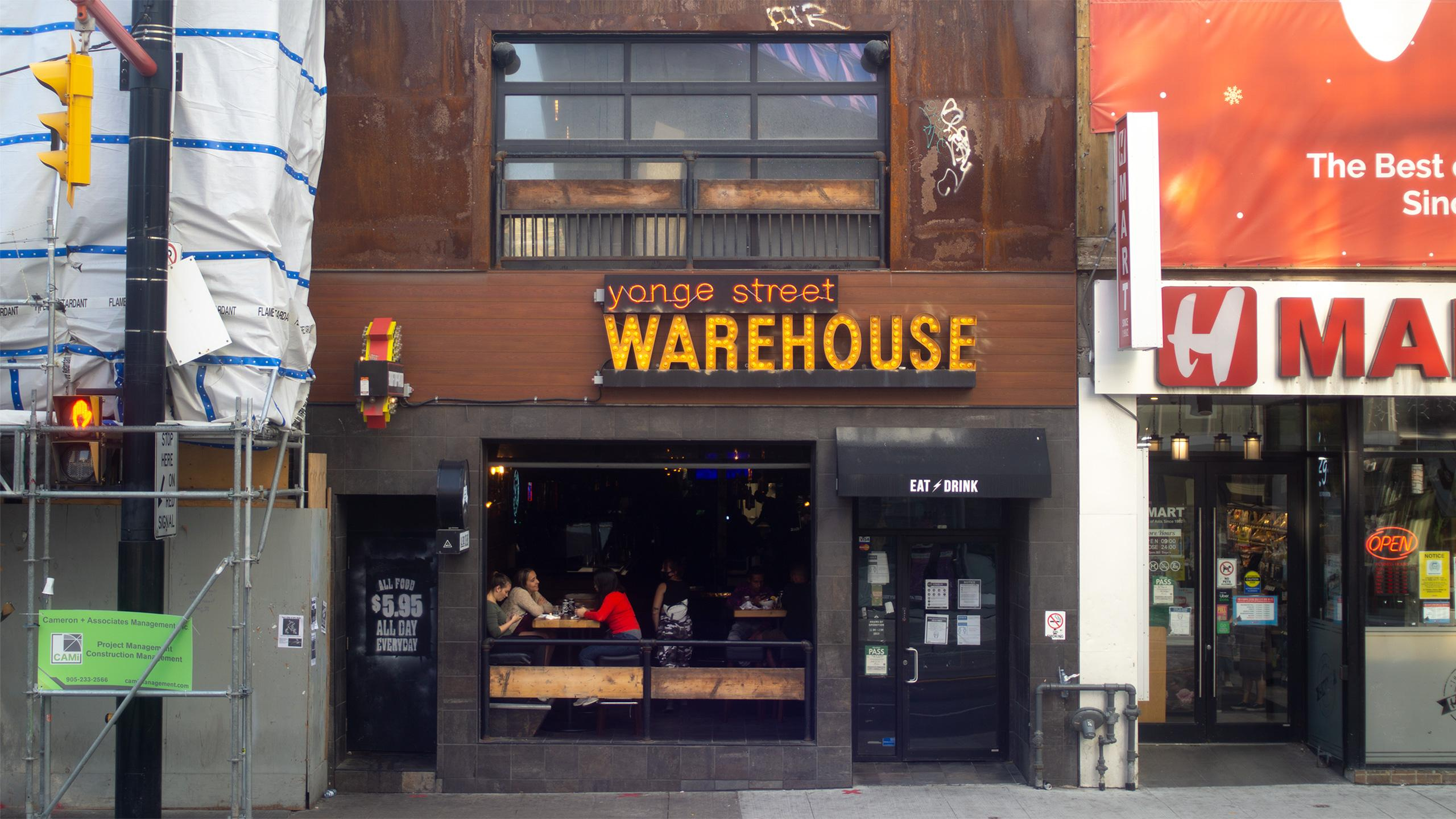 Photo of Warehouse, a busy bar on Yonge Street.