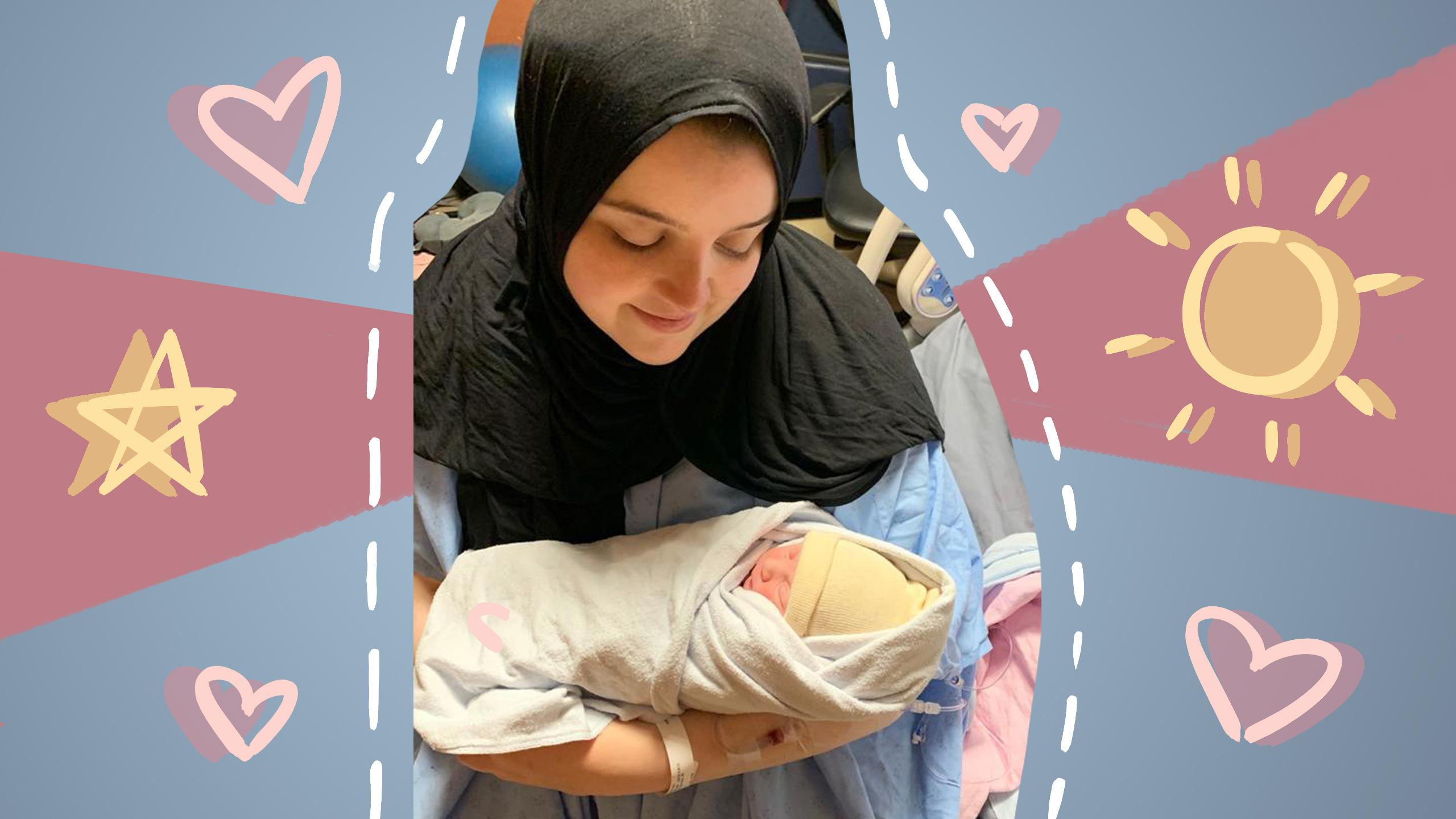 A smiling woman sitting in a hospital bed wearing a hijab holding a newborn baby in her arms.