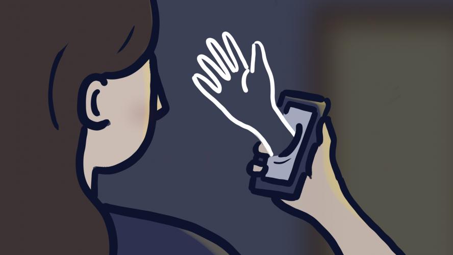 A person looking at their cellphone in a dark room as a phantom hand reaches through the screen.
