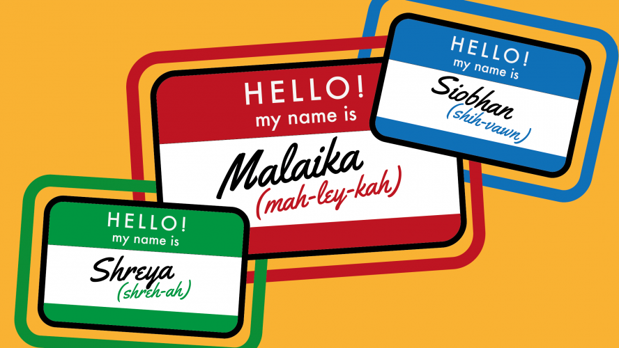 A group of name tags with phonetic pronunciations written on them.