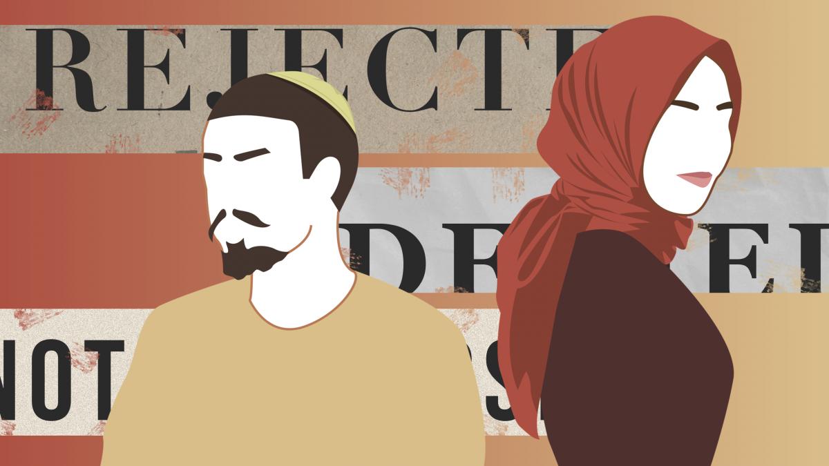 A man wearing a yarmulke and a woman wearing a hijab.