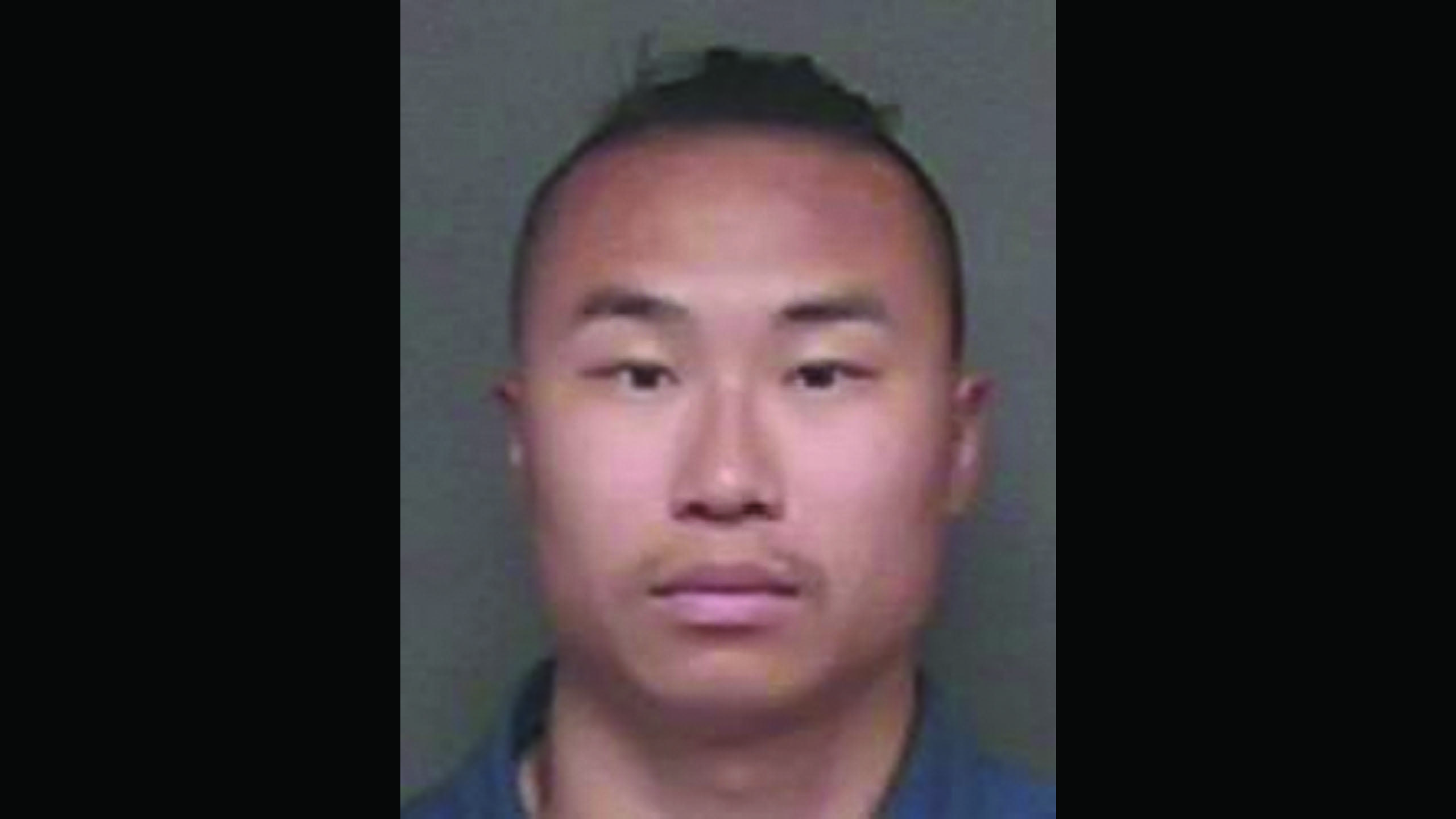 The image shows a photo of a young Asian man with short black hair.