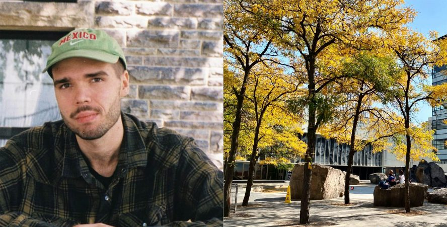 A person wearing a green baseball cap and a green flannel aside trees near the Lake Devo area.