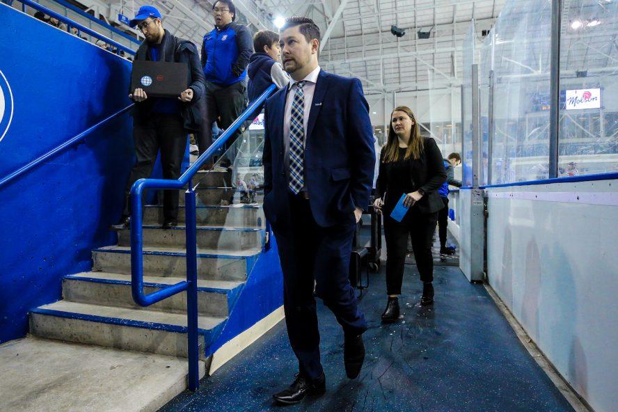 Hockey coach walks